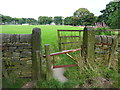 SE0422 : Gate and stile on Sowerby Bridge FP99 by Humphrey Bolton