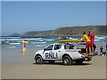 SW3526 : RNLI lifeguards on duty on Sennen beach by Rod Allday