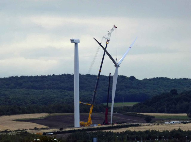 In failing light the wind turbine blades are installed #2