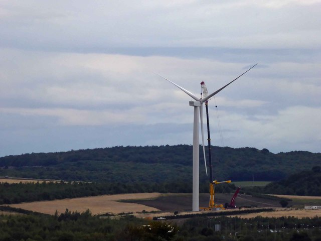 In failing light the wind turbine blades are installed #5