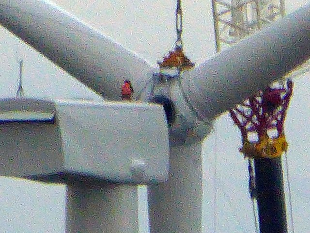 In failing light the wind turbine blades are installed #6