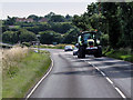 TG1140 : Tractor on Cromer Road by David Dixon