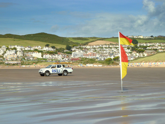 RNLI vehicle and bathing flags on Woolacombe Sand
