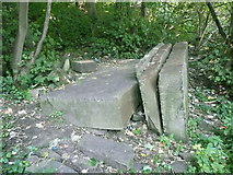 SE1321 : Abandoned pieces of stone next to Brighouse FP99, Rastrick by Humphrey Bolton