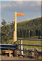NT2624 : A signpost and stile by the A708 near Kirkstead by Walter Baxter