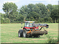 SP9114 : Tractor with Disc Harrow in field by Aylesbury Arm of Canal by Chris Reynolds