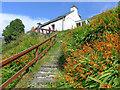 NB2201 : Path to the entrance to Rhenigidale Hostel by Julian Paren