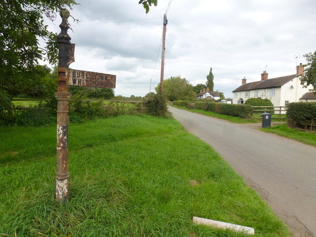Dilapidated signpost in Wilkesley