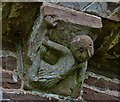 SO4430 : Kilpeck: The church of St. Mary and St. David: Corbel of lady contortionist? by Michael Garlick
