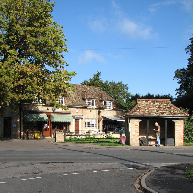 Barton: shoe shop, post office and bus shelter