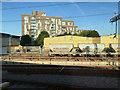 TQ2983 : Flats and cement wagons seen from a Eurostar train near St Pancras, London by Robin Stott