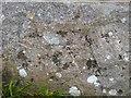 SM7624 : Worn benchmark on limekiln, Caer Bwdy Bay, Pembrokeshire by Becky Williamson