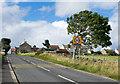 NZ0726 : Road entering Woodland by Trevor Littlewood