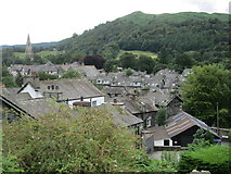 NY3704 : Ambleside – Loughrigg, the church and roof tops by Peter S