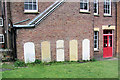 SP9212 : Old tombstones in the wall of the Baptist Church Hall, New Mill by Chris Reynolds