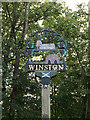 TM1861 : Winston Village sign by Adrian Cable