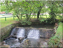 TQ2992 : Weir on Pymme's Brook in Arnos Park by Mike Quinn