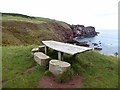 NT9167 : Picnic table above Starney Bay by Oliver Dixon