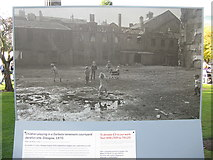 NT2574 : Children playing in a Gorbals tenement courtyard by M J Richardson