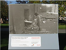 NT2574 : Mother takes her baby inside her condemned tenement block by M J Richardson