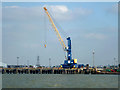TQ9074 : Crane on jetty, Sheerness by Robin Webster