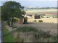 NT8958 : Barn and bales, Blackburn Farm by Oliver Dixon