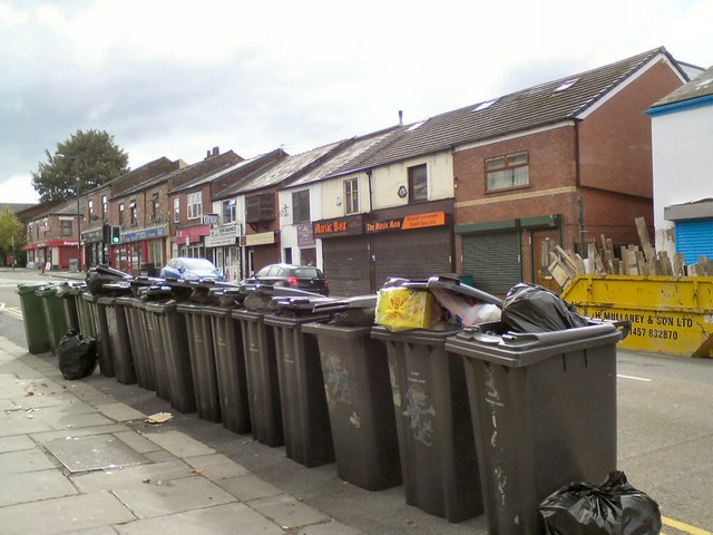 Overflowing wheelie bins on Market Street