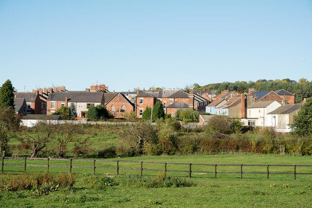 Houses of Coundon Grange from minor road through Eldon