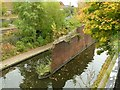 SP0487 : Brick wall in the middle of the canal by Alan Murray-Rust