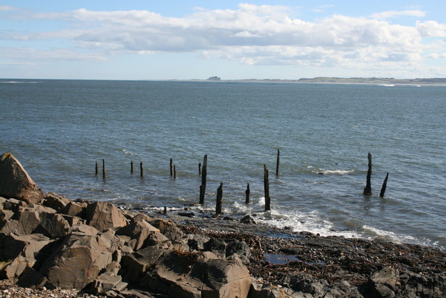Shoreline by Lindisfarne Castle looking towards Bamburgh Castle
