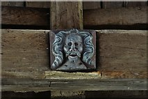 SP9599 : Wakerley: St. John the Baptist church: Amusing nave roof boss 2 by Michael Garlick