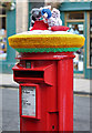 NT4728 : A yarn-bombed pillar box in Selkirk High Street by Walter Baxter