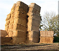 TM2690 : Straw bales stored on farm hardstanding by Evelyn Simak