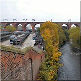 SJ8990 : River, viaduct and bus station by Gerald England