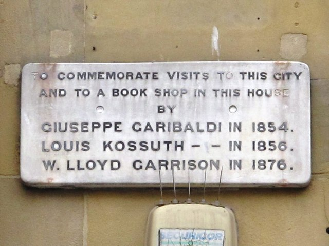 Photo of Giuseppe Garibaldi, Louis Kossuth, and William Lloyd Garrison stone plaque
