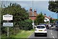 TG2916 : Entering Wroxham via Norwich Road by David Dixon