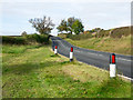 NZ2630 : Bollards beside road climbing towards Kirk Merrington by Trevor Littlewood