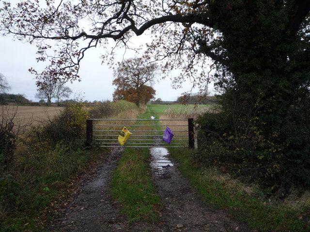 Gated farm track off the B6275