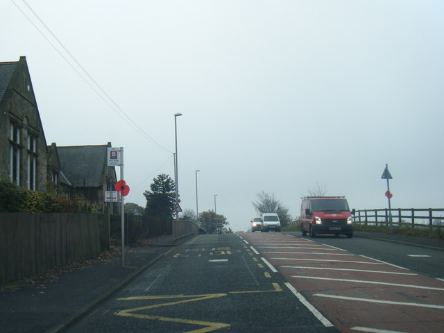 A692 at Marley Hill School, with poppy on bus stop
