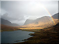NB1005 : A rainbow over Loch Mhiabhaig by John Lucas