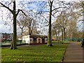 TQ2483 : Toilet block and play area, Queen's Park by David Smith