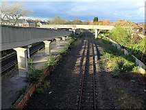 NZ3265 : Railway line & footbridge near Jarrow Metro Station by Andrew Curtis