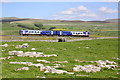 SD7876 : Train heads towards Leeds over Selside Shaw Rigg by Roger Templeman