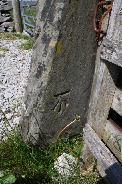 Benchmark on gatepost beside Ingman Lodge Road