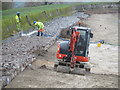 SP9113 : Repairing Startops Reservoir (9) Hosing down the boulders by Chris Reynolds