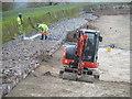 SP9113 : Repairing Startops Reservoir (9) Hosing down the boulders by Chris Reynolds