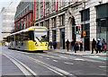 SJ8498 : Metrolink Tram Passing The Printworks by David Dixon