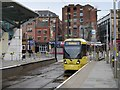 SJ8498 : Tram Arriving at Shudehill Interchange by David Dixon