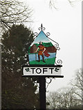 TL3656 : Toft Village sign by Adrian Cable