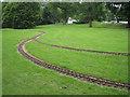SO1091 : Miniature railway tracks, riverside open space, Newtown, Powys by Robin Stott